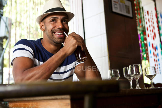 Smiling Man in cafe with a drink — Stock Photo