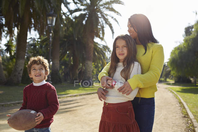 Mother, daughter and son in park — Stock Photo