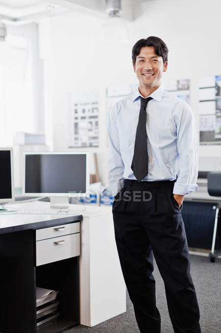 Businessman smiling in office — Stock Photo