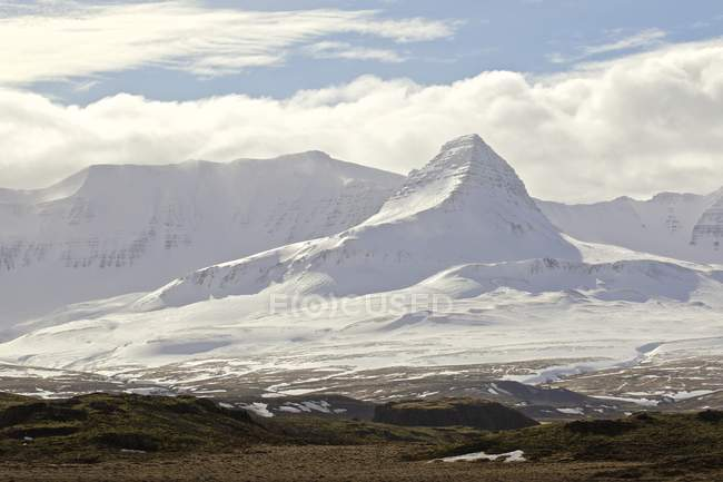Scenic view of snow covered mountains and cloudy sky, Iceland — Stock Photo