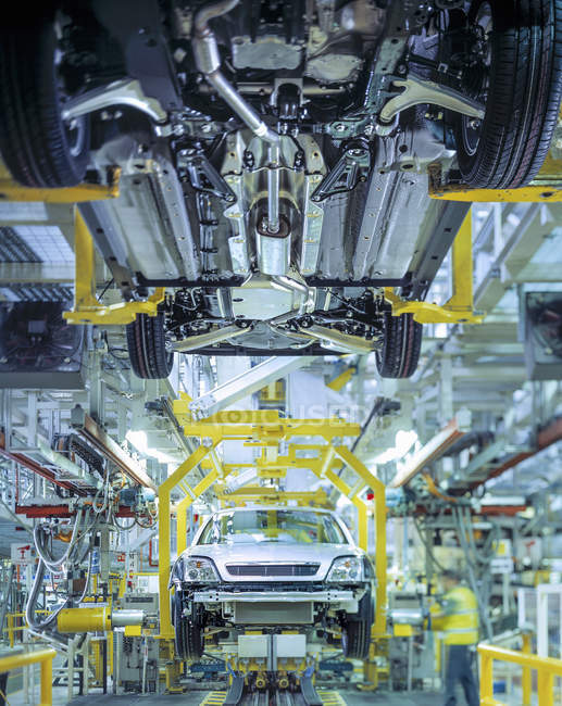 Cars on production line in car factory — Stock Photo