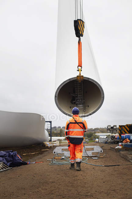 Engineer working at wind farm, rear view — Stock Photo