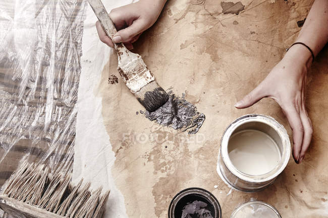 Woman painting on material, close-up — Stock Photo