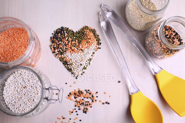 Lentil heart shape on table — Stock Photo