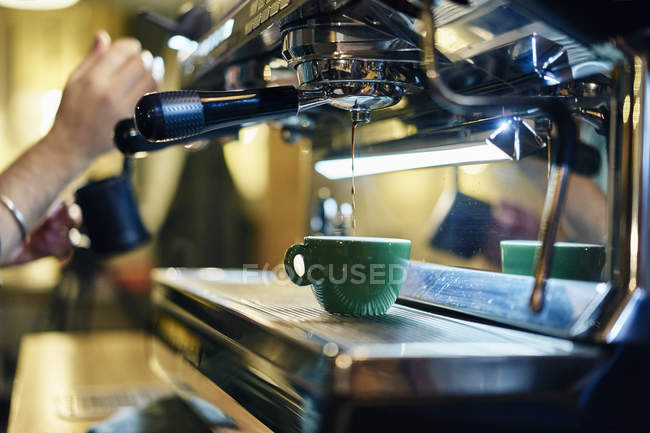 Cropped image of barista making coffee — Stock Photo