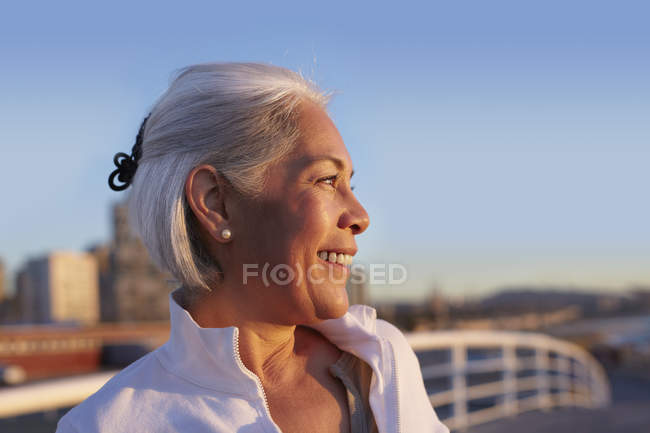 Close up profile of silver-haired mature woman — Stock Photo