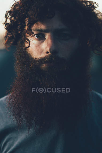 Portrait of staring, bearded young male hipster — Stock Photo