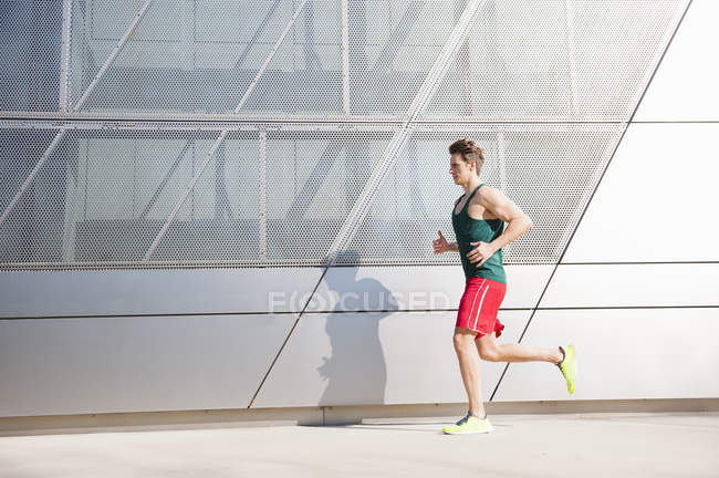 Mid adult man running in city — Stock Photo