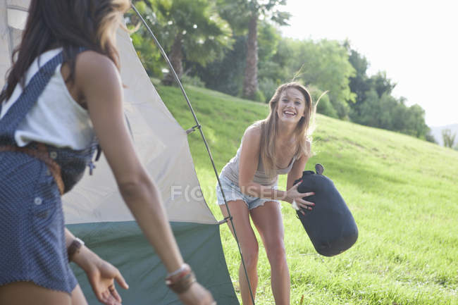 Two young females friends having fun whilst camping — Stock Photo