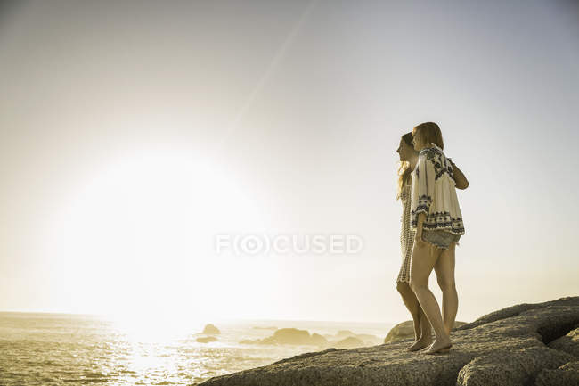 Two mid adult women looking out beach, Cape Town, South Africa — Stock Photo