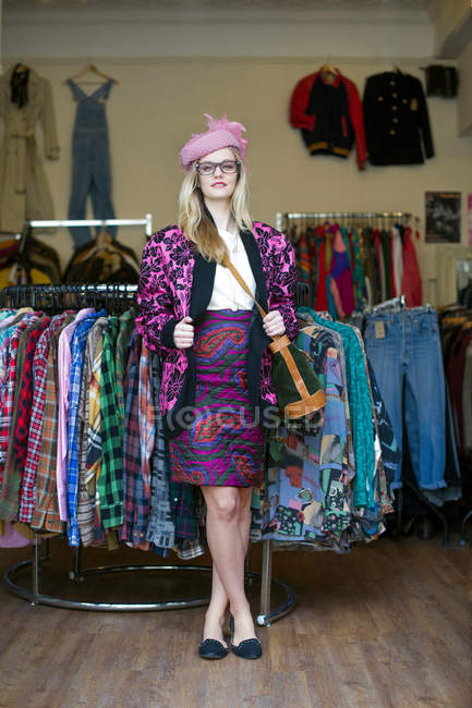 Woman in vintage clothes standing in shop — Stock Photo