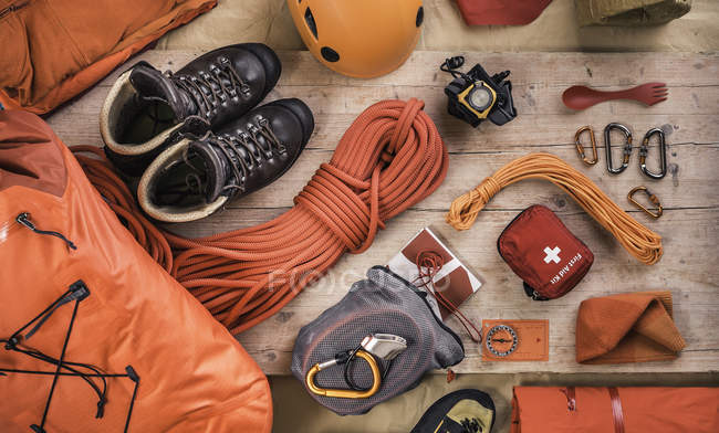 Top view of climbing equipment with climbing helmet, first aid kit, climbing boots and climbing ropes — Stock Photo