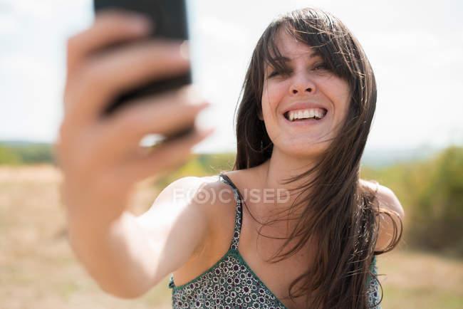 Mid adult woman taking self portrait photograph — Stock Photo