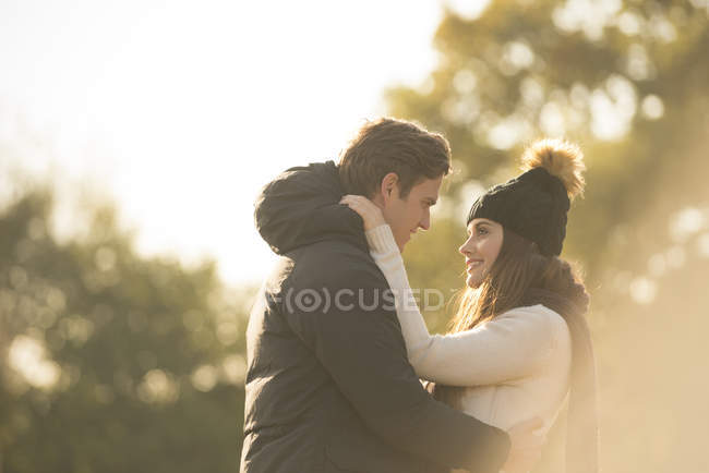 Young couple smiling face to face in rural setting — Stock Photo