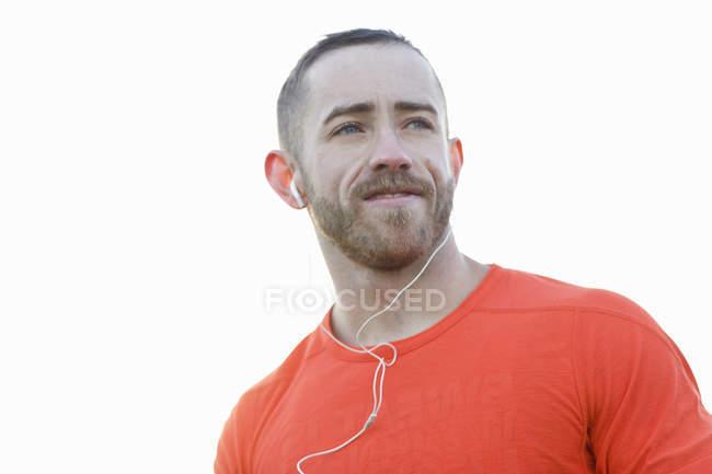 Portrait of young man wearing earphones — Stock Photo