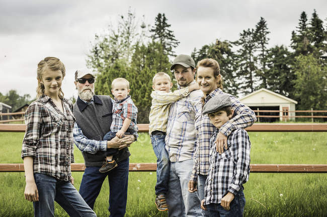 Multi generation on farm looking at camera smiling — Stock Photo