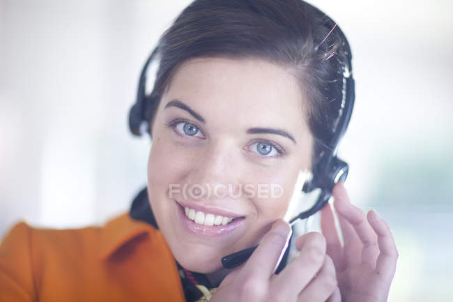 Businesswoman wearing telephone headset — Stock Photo