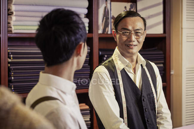 Father and son in family tailors shop — Stock Photo