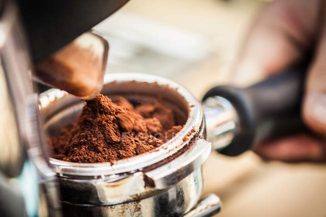 Close up of espresso grounds in machine — Stock Photo