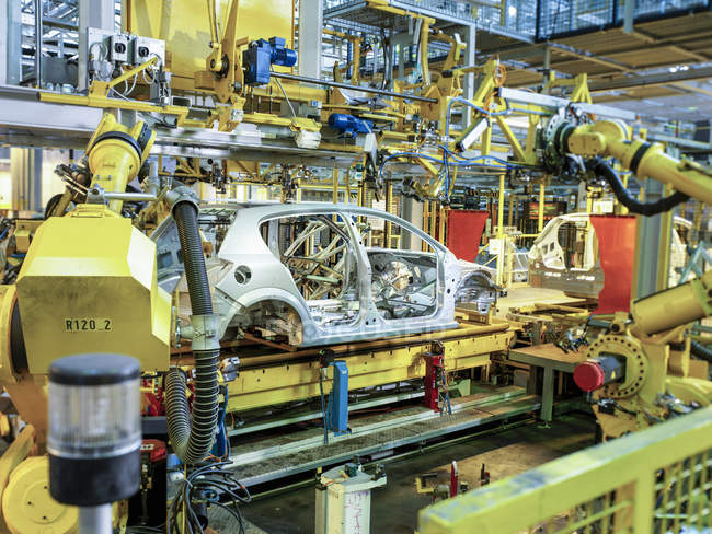 Indoors precision assembly line at automobile factory, Cheshire, England — Stock Photo