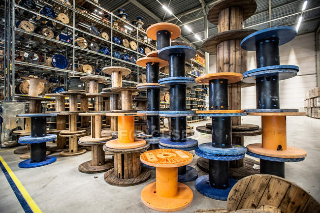 Many wire reels at distribution warehouse — Stock Photo