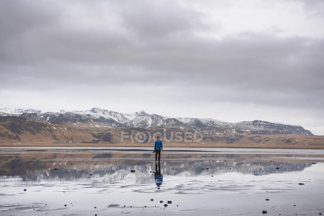 Man looking at view, Dyrholaos, Iceland — Stock Photo