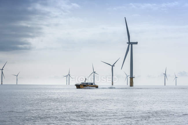 View of offshore windfarm and service boat — Stock Photo