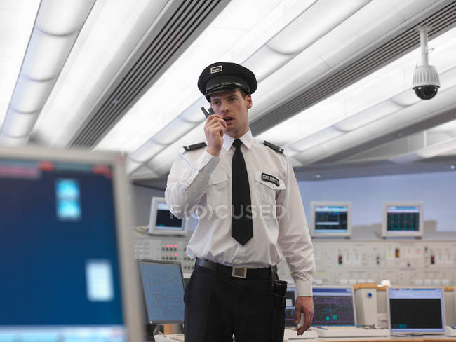 Security guard talking on radio — Stock Photo