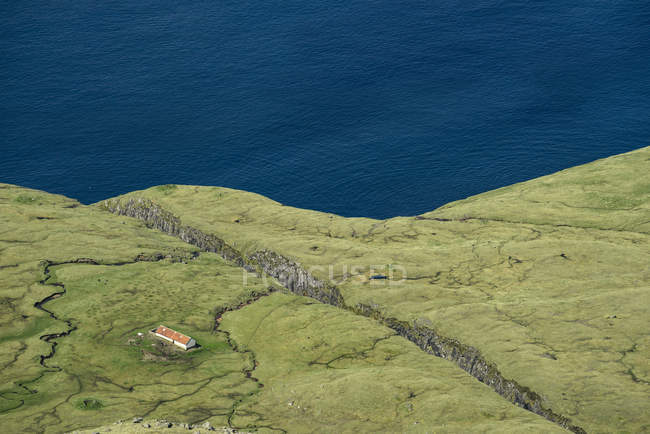 High angle view of building on cliff top, Vagafjordur, Faroe Islands — Stock Photo