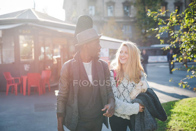 Couple walking on pavement outdoors at daytime — Stock Photo