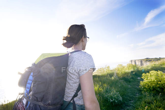 Rear view of hiker with backpack looking away — Stock Photo