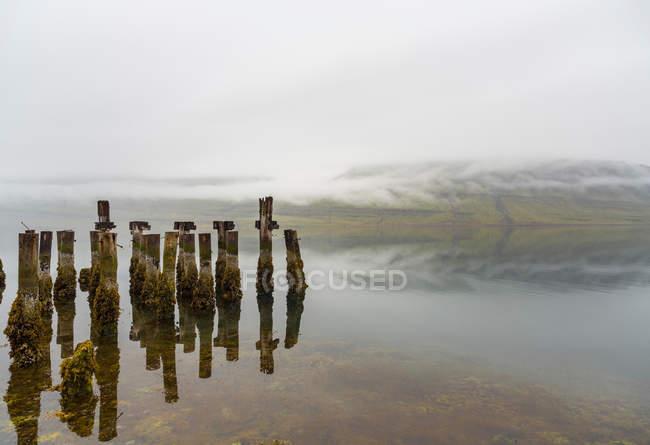 Abandoned pier on lake, Reydarfjordur, Iceland — Stock Photo