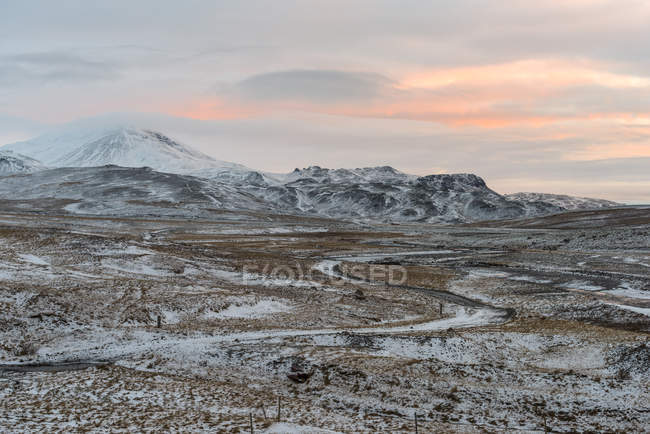 Scenic view of snowcapped mountains and valley at sunset, Mosfell, Iceland — Stock Photo