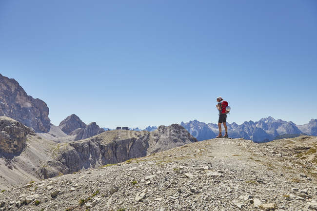 Rear view of female hiker looking out at Dolomites, Sexten, South Tyrol, Italy — Stock Photo