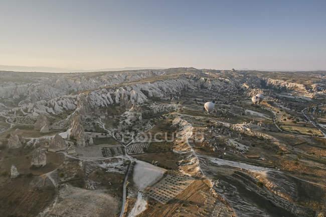 Distant view of hot air balloons over landscape, Cappadocia, Anatolia,Turkey — Stock Photo