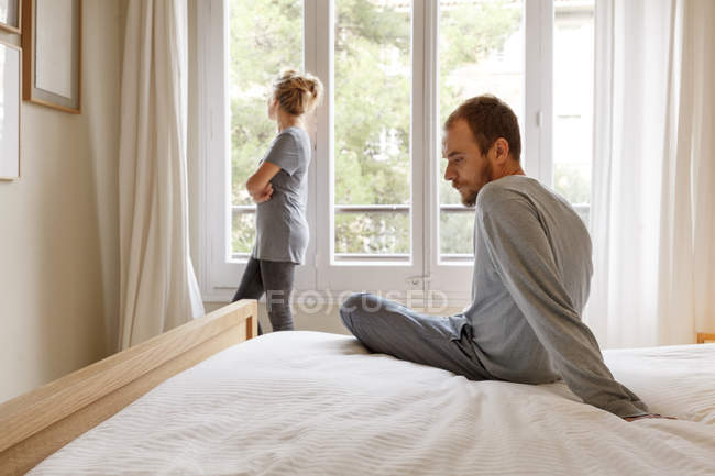 Mid adult couple in bedroom, having disagreement — Stock Photo