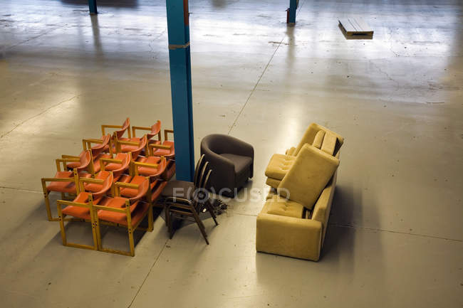 Chairs in empty warehouse — Stock Photo