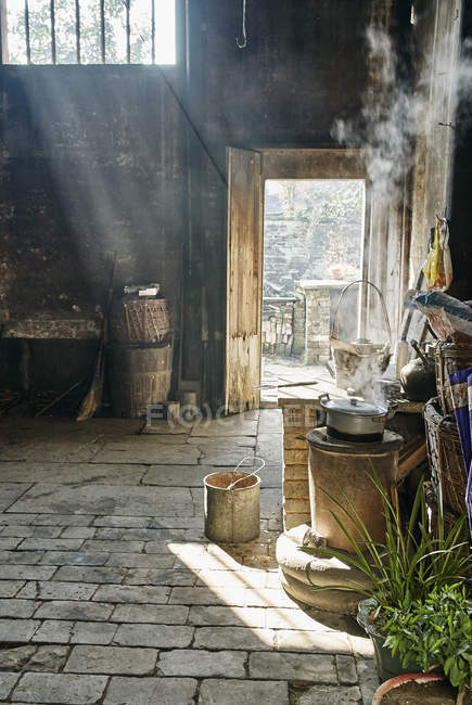 Stove and flagstones in interior space, Hongcun Village, Anhui Province, China — Stock Photo