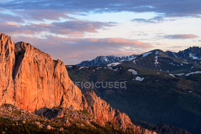 Sun lighted rock formation and landscape at dusk — Stock Photo