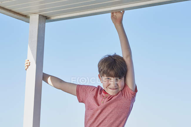 Portrait of boy looking at camera smiling — Stock Photo