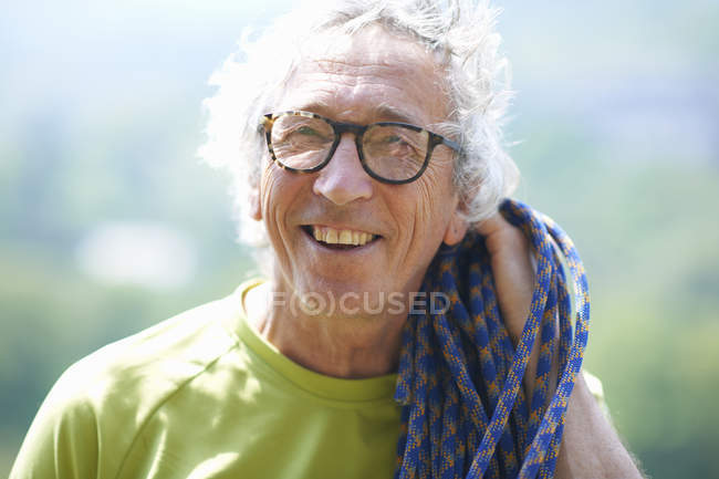 Portrait of rock climber looking at camera smiling — Stock Photo