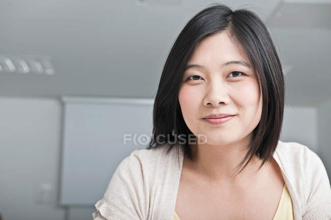 Portrait of asian woman looking to camera — Stock Photo