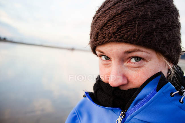 Portrait of Woman on beach in winter — Stock Photo