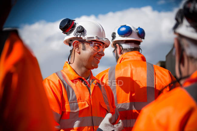 Portrait of railway workers wearing protective clothing — Stock Photo