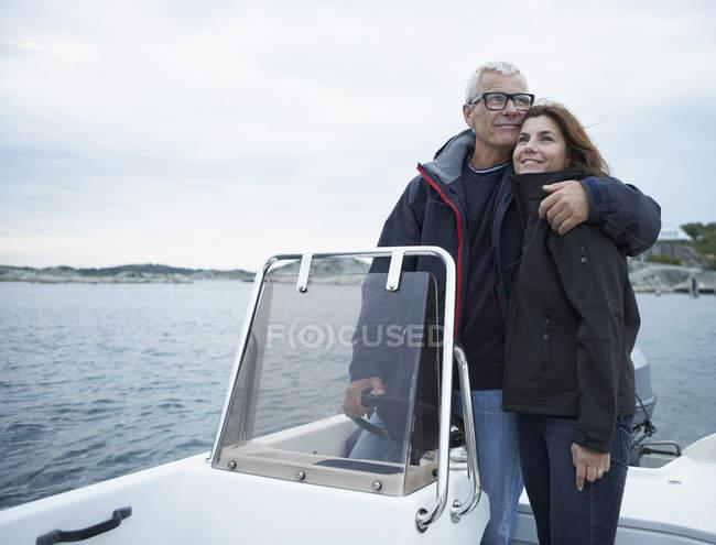 Middle aged couple on motor boat — Stock Photo