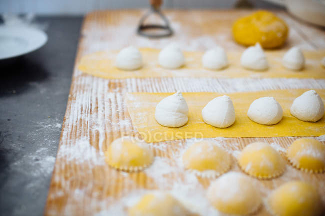 Traditional Italian food preparation, pasta and ricotta on floured table, Campania, Italy — Stock Photo