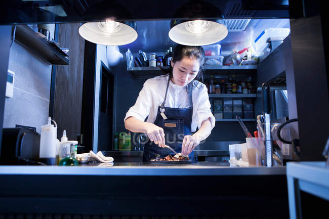 Asian Chef in commercial kitchen preparing food — Stock Photo