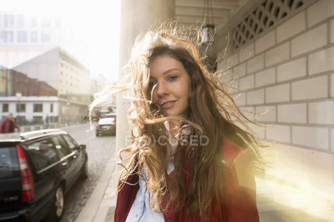 Woman with windblown hair enjoying sun outdoors — Stock Photo