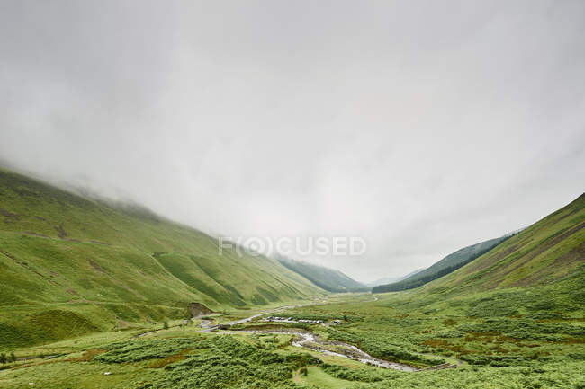 Green vegetation in beautiful mountains at cloudy day, grey mares tail, scotland — Stock Photo