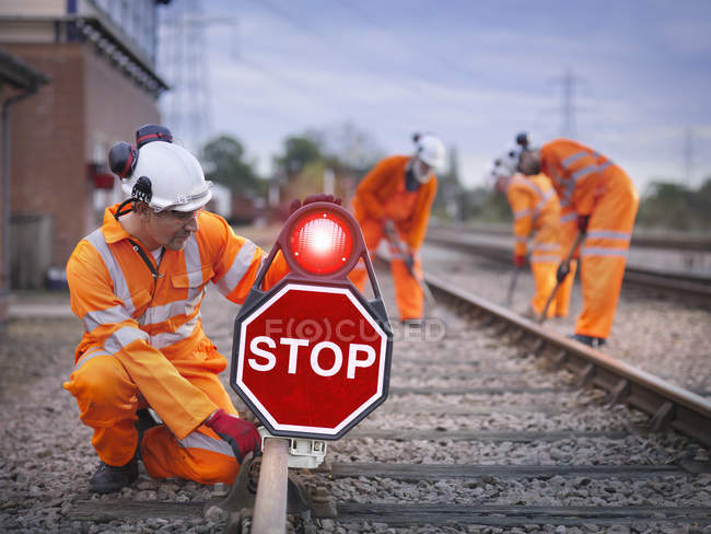 Railway maintenance workers on track with stop sign in Loughborough, England, UK — Stock Photo